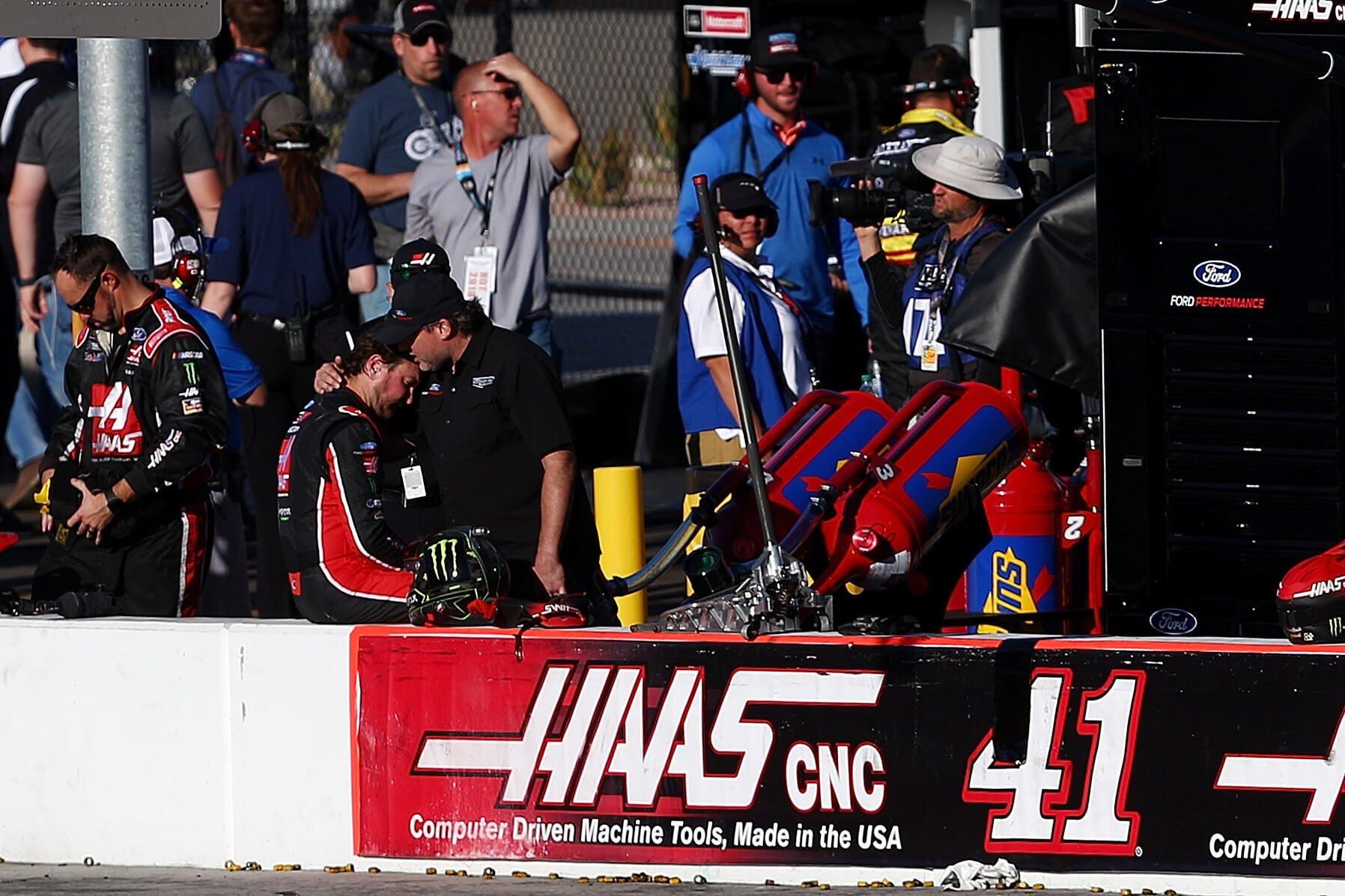 Kurt Busch and Tony Stewart embrace after the NASCAR race at ISM Raceway