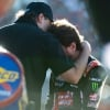 Kurt Busch and car owner Tony Stewart embrace after the NASCAR race at ISM Raceway