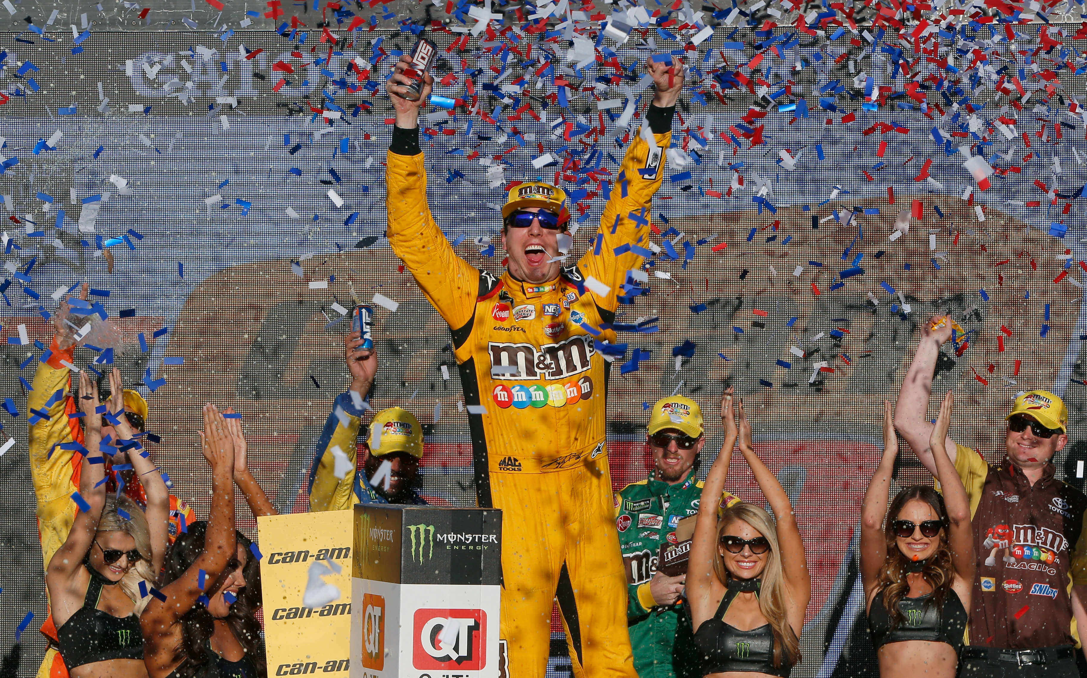 Kyle Busch and the Monster Energy Girls in victory lane at ISM Raceway - NASCAR Cup Series