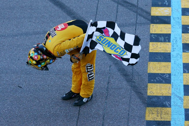 Kyle Busch takes a bow after winning at ISM Raceway