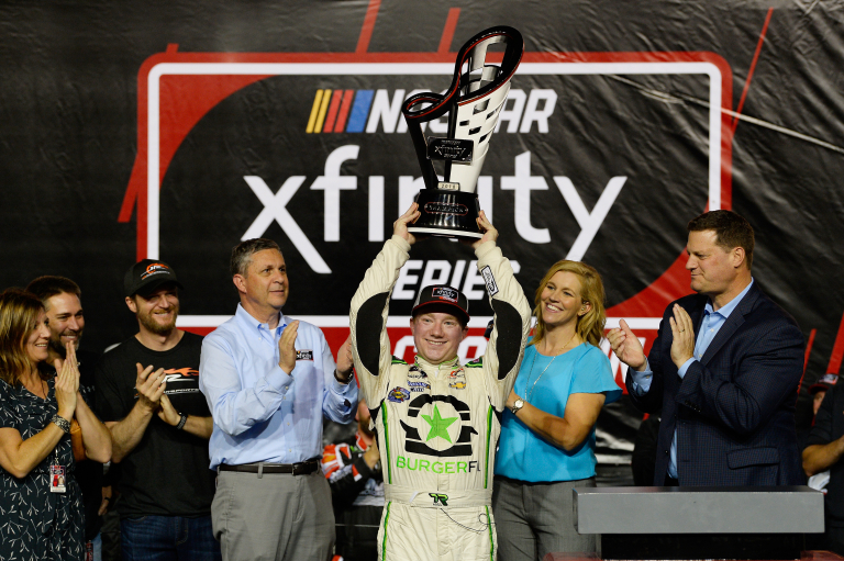Tyler Reddick, Kelley Earnhardt Miller and Dale Earnhardt Jr with the 2018 NASCAR Xfinity Series championship trophy