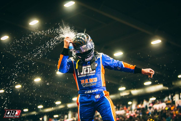 Justin Grant smashes NOS Energy Drink on his helmet after winning in the Chili Bowl Nationals