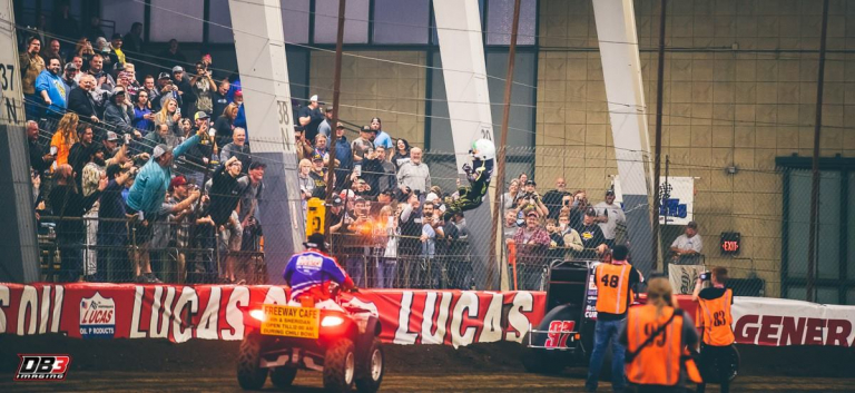 Rico Abreu climbs the fence after the Chili Bowl Nationals win
