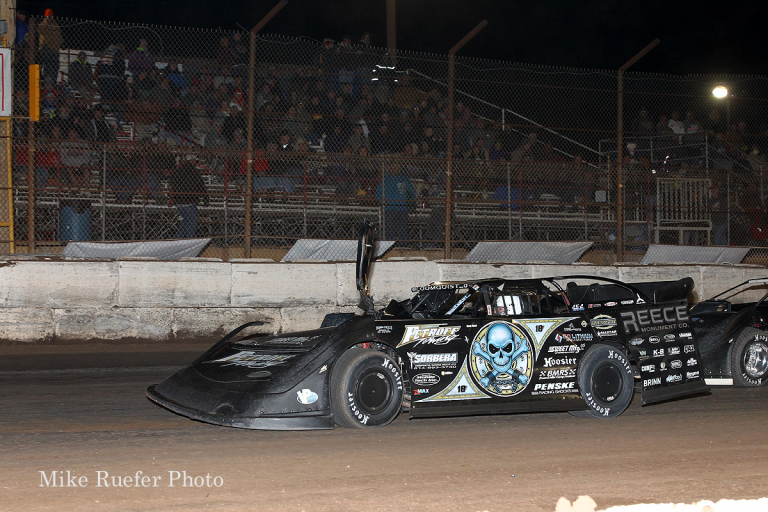 Scott Bloomquist crashes with a lap car while leading in the Wild West Shootout