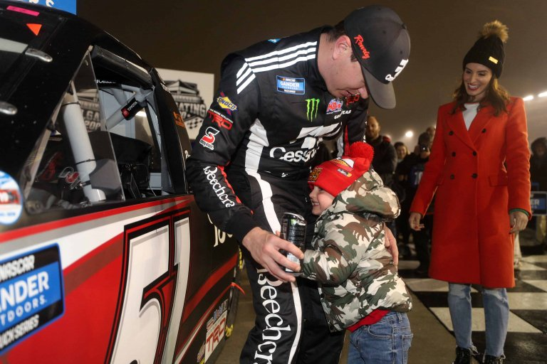 Kyle Busch, Brexton Busch and Samantha Busch in victory lane at Atlanta Motor Speedway