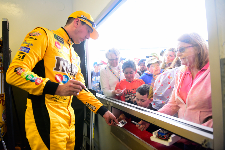 Kyle Busch signs autographs for NASCAR fans