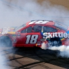 Kyle Busch does a burnout after winning at ISM Raceway - Monster Energy NASCAR Cup Series - TicketGuardian 500