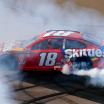 Kyle Busch does a burnout after winning at ISM Raceway - Monster Energy NASCAR Cup Series - TicketGuardian 500