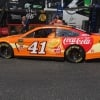 Daniel Suarez - Orange Vanilla Coke NASCAR race car at Talladega Superspeedway