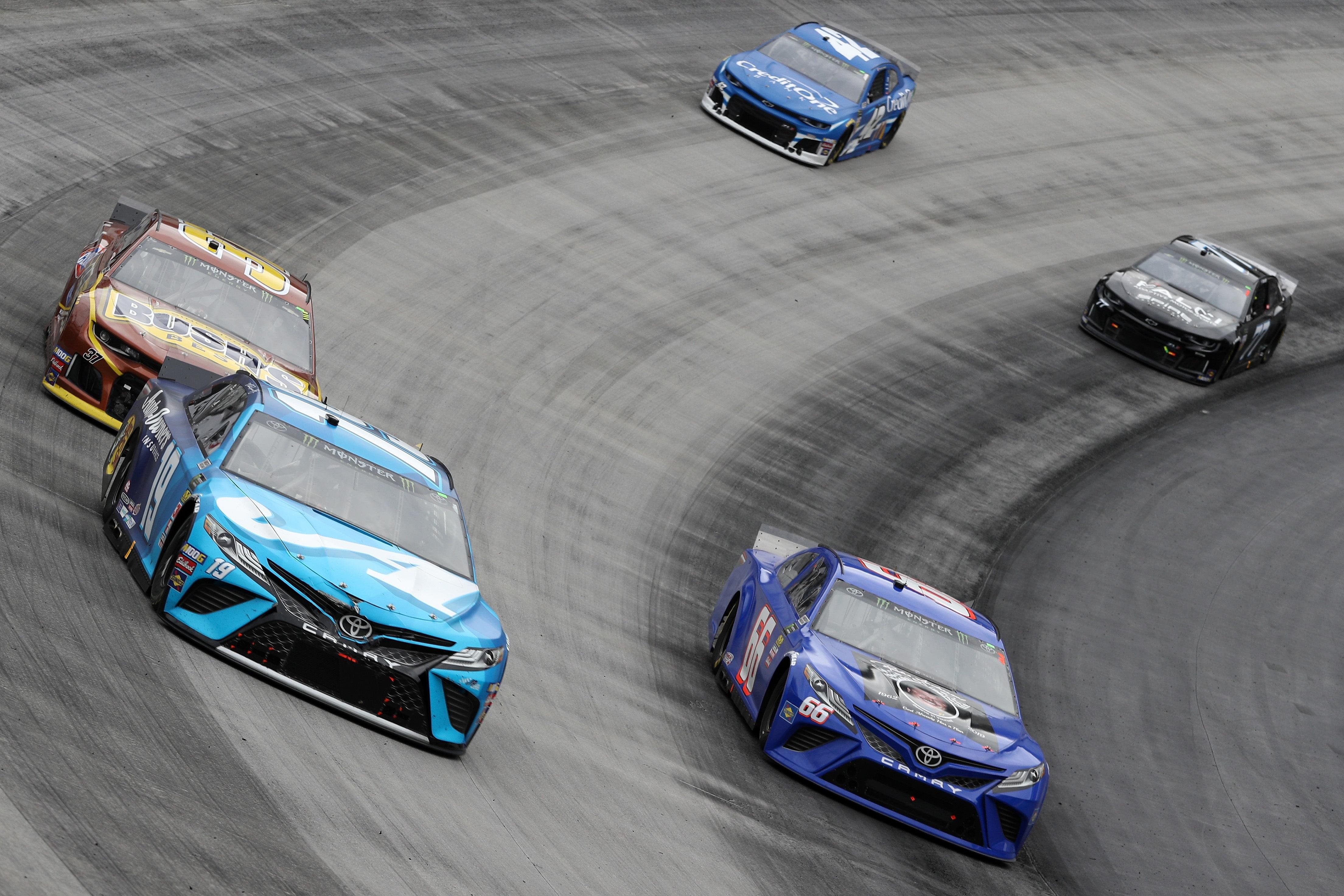Martin Truex Jr, Chris Buescher and Kyle Larson at Bristol Motor Speedway