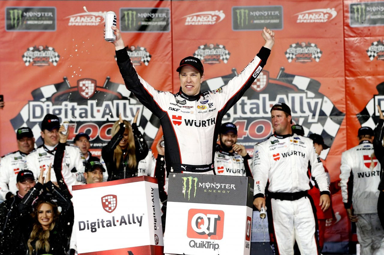 Brad Keselowski in victory lane at Kansas Speedway