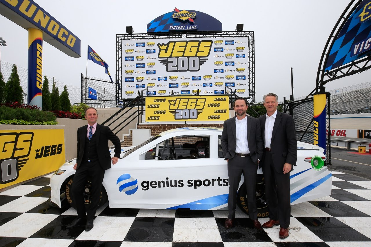 Chris Dougan, Scott Warfield and NASCAR president Steve Phelps with Genius Sports race car at Dover