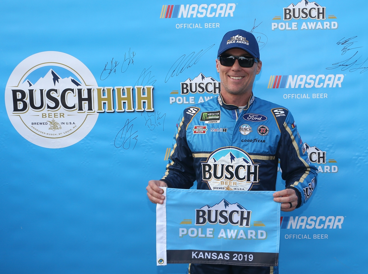 Kevin Harvick wins the Busch pole at Kansas Speedway