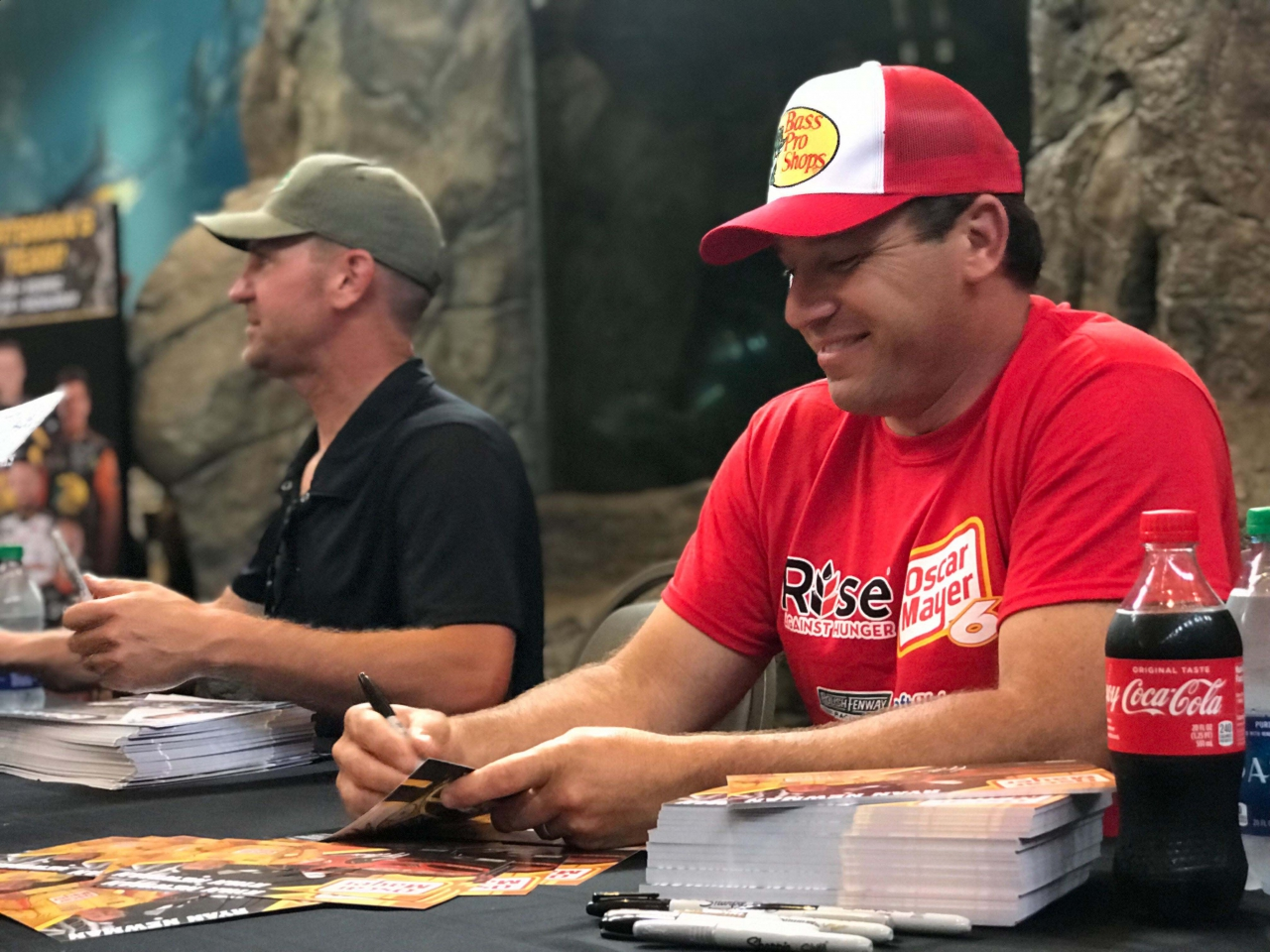 Ryan Newman and CLint Bowyer sign autographs at Bass Pro Shops