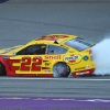 Joey Logano does a burnout after winning at Michigan International Speedway