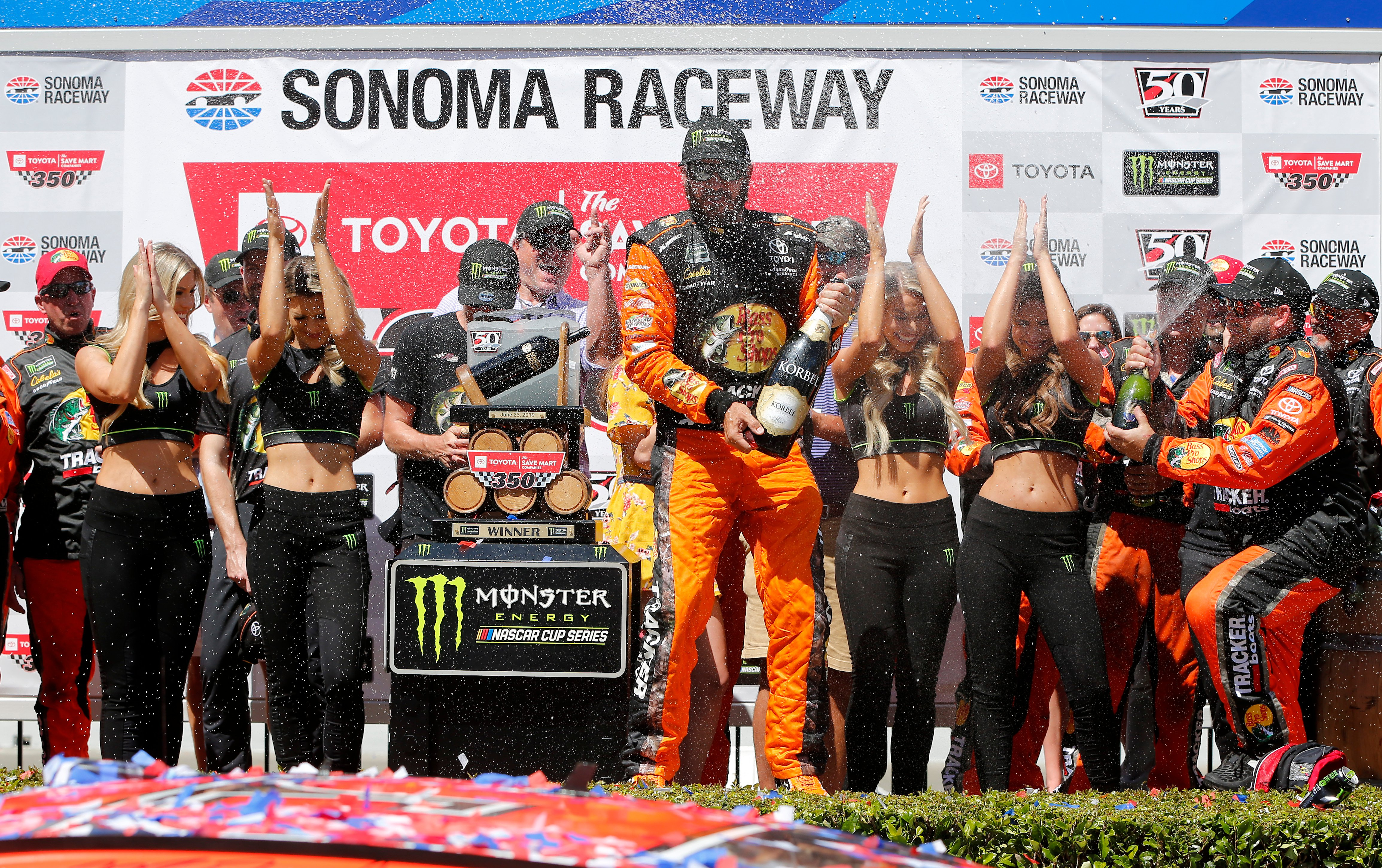 Martin Truex Jr and the Monster Energy Girls in Sonoma Raceway victory lane