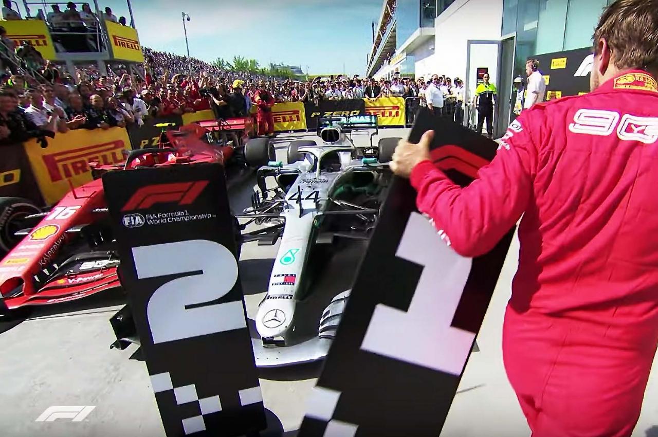 Sabastian Vettel moves podium number boards after Canadian Grand Prix