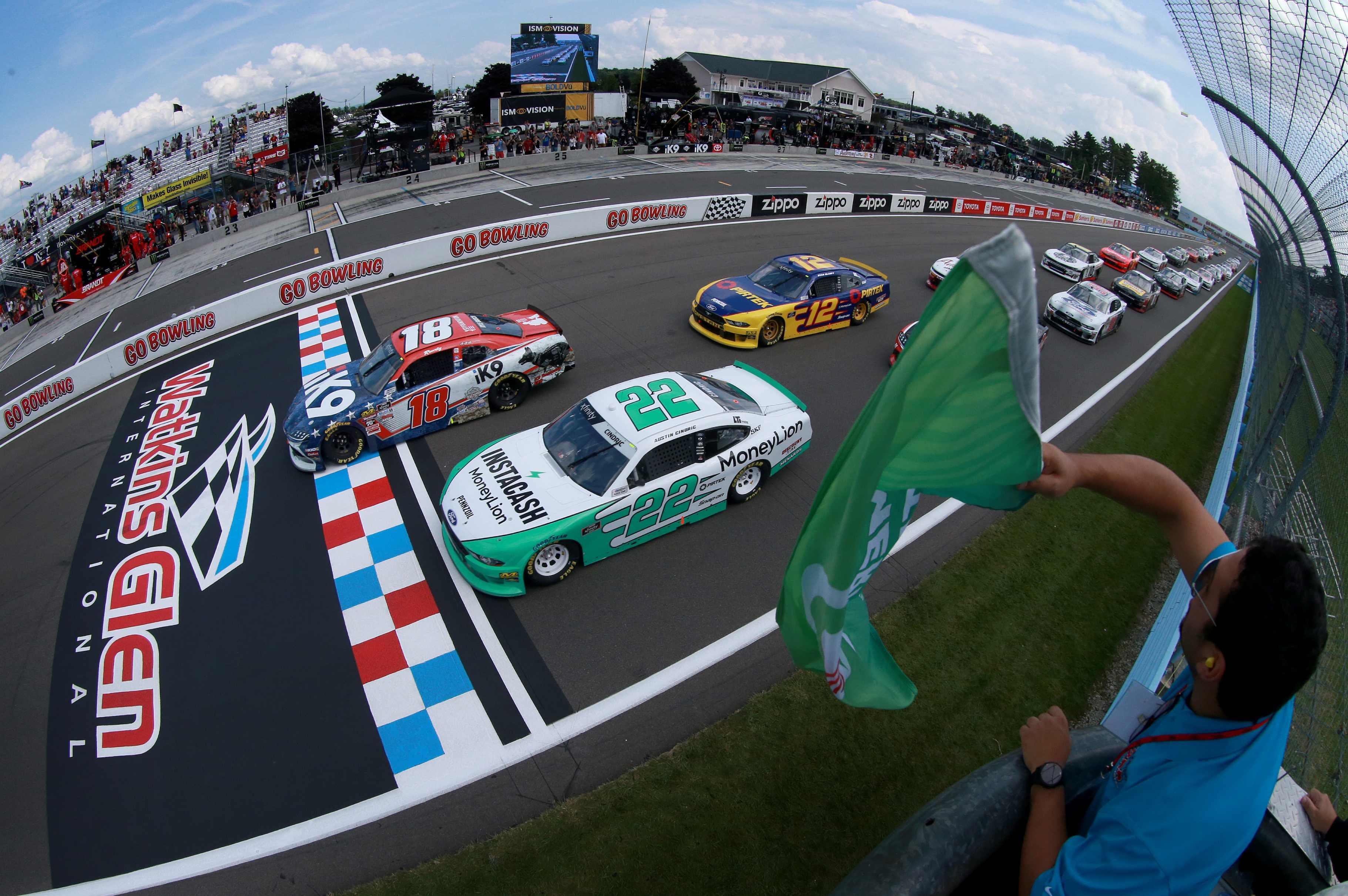 Austin Cindric, Kyle Busch and Ryan Blaney take the NASCAR Xfinity Series green flag at Watkins Glen International.jpg