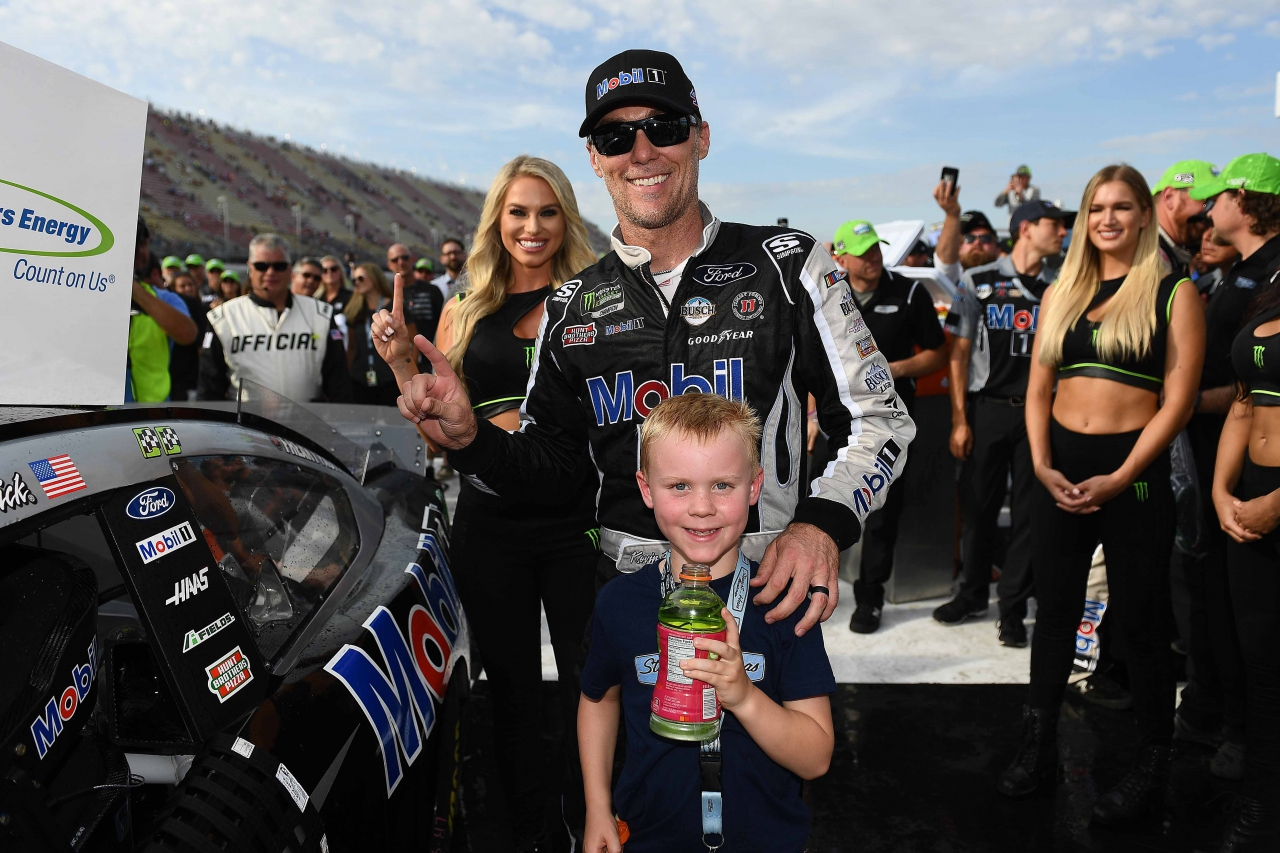 Kevin Harvick and Keelan Harvick in victory lane at Michigan International Speedway