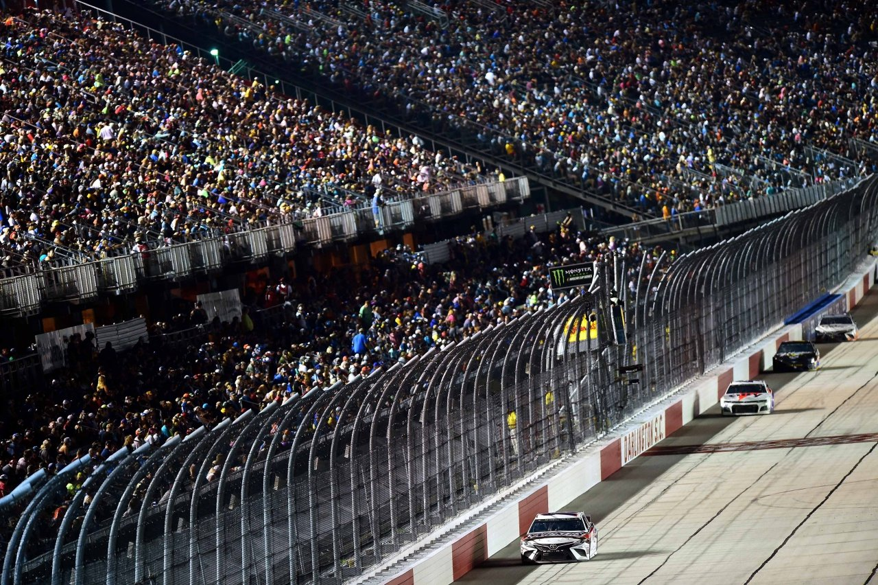 Kyle Busch leads Jimmie Johnson at Darlington Raceway - NASCAR Grandstands - Sold out crowd