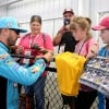 Kyle Busch signs autographs for NASCAR fans at Richmond Raceway