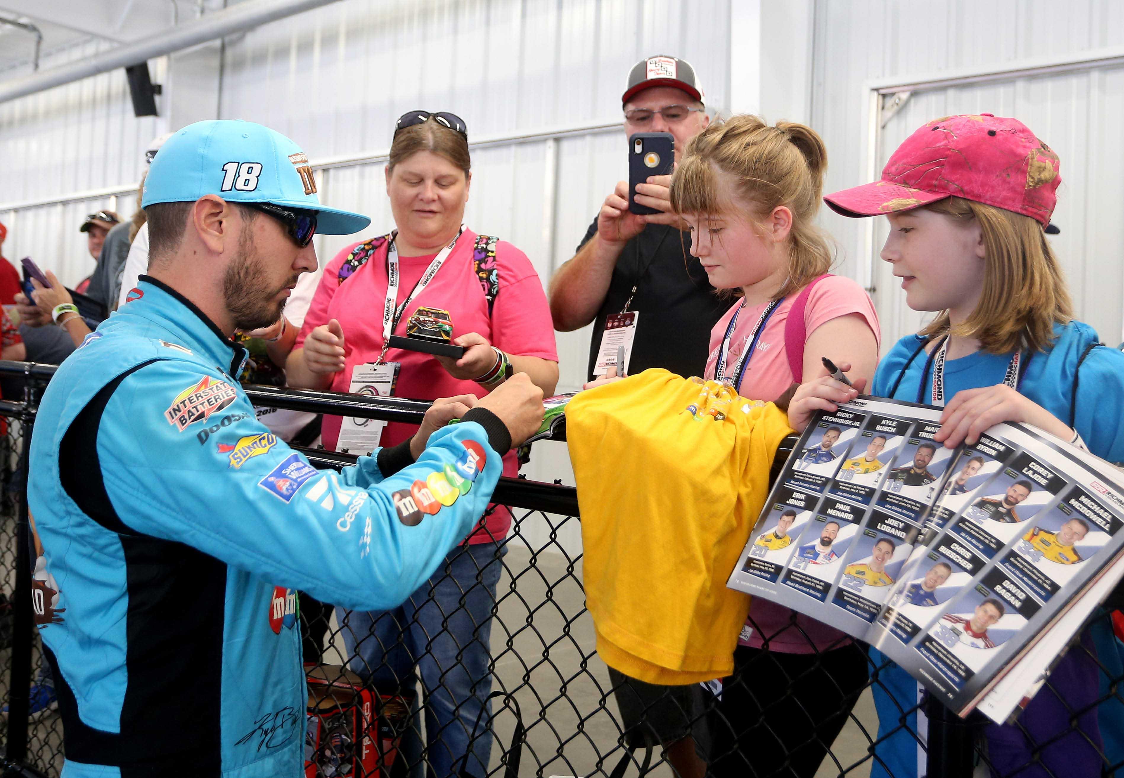 Kyle Busch signs autographs for NASCAR fans at Richmond Raceway
