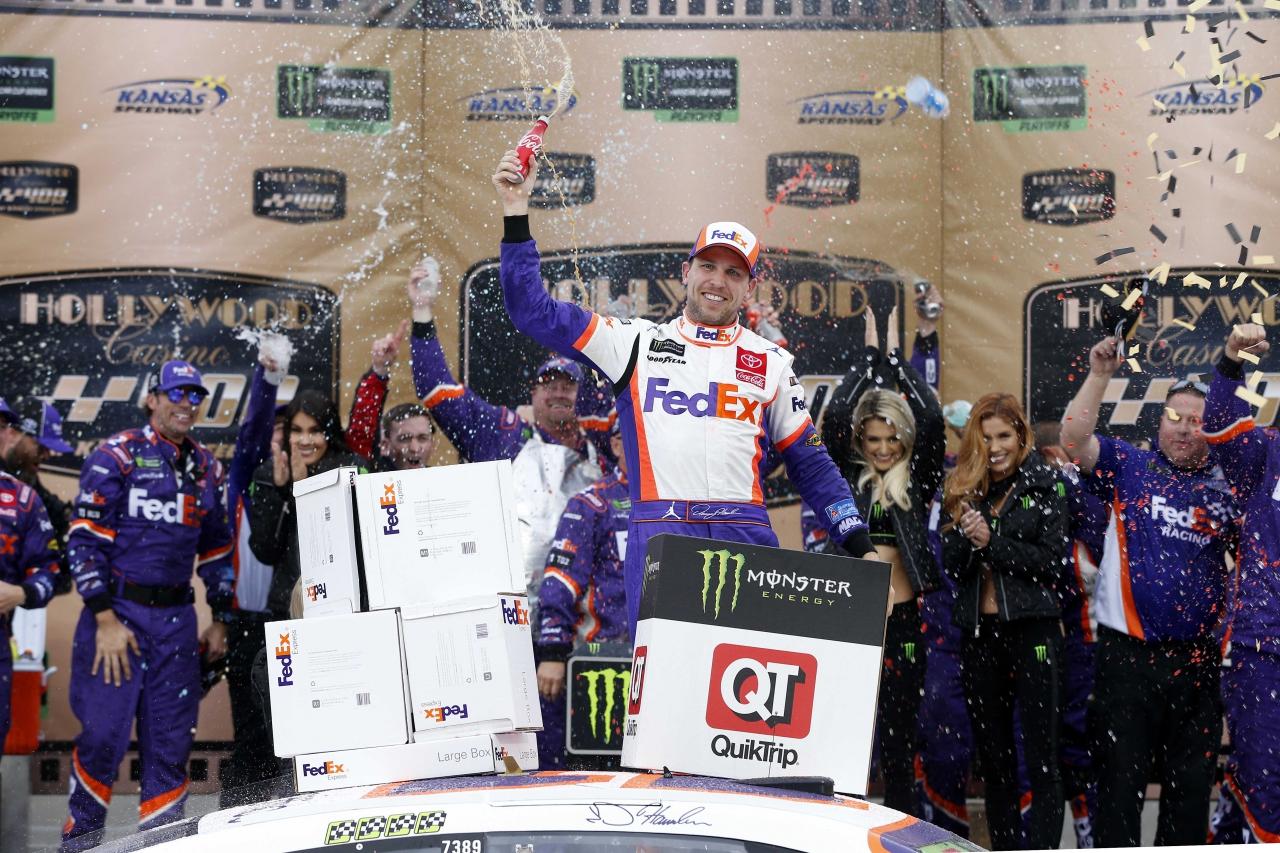 Denny Hamlin in victory lane with the Monster Energy Girls - NASCAR