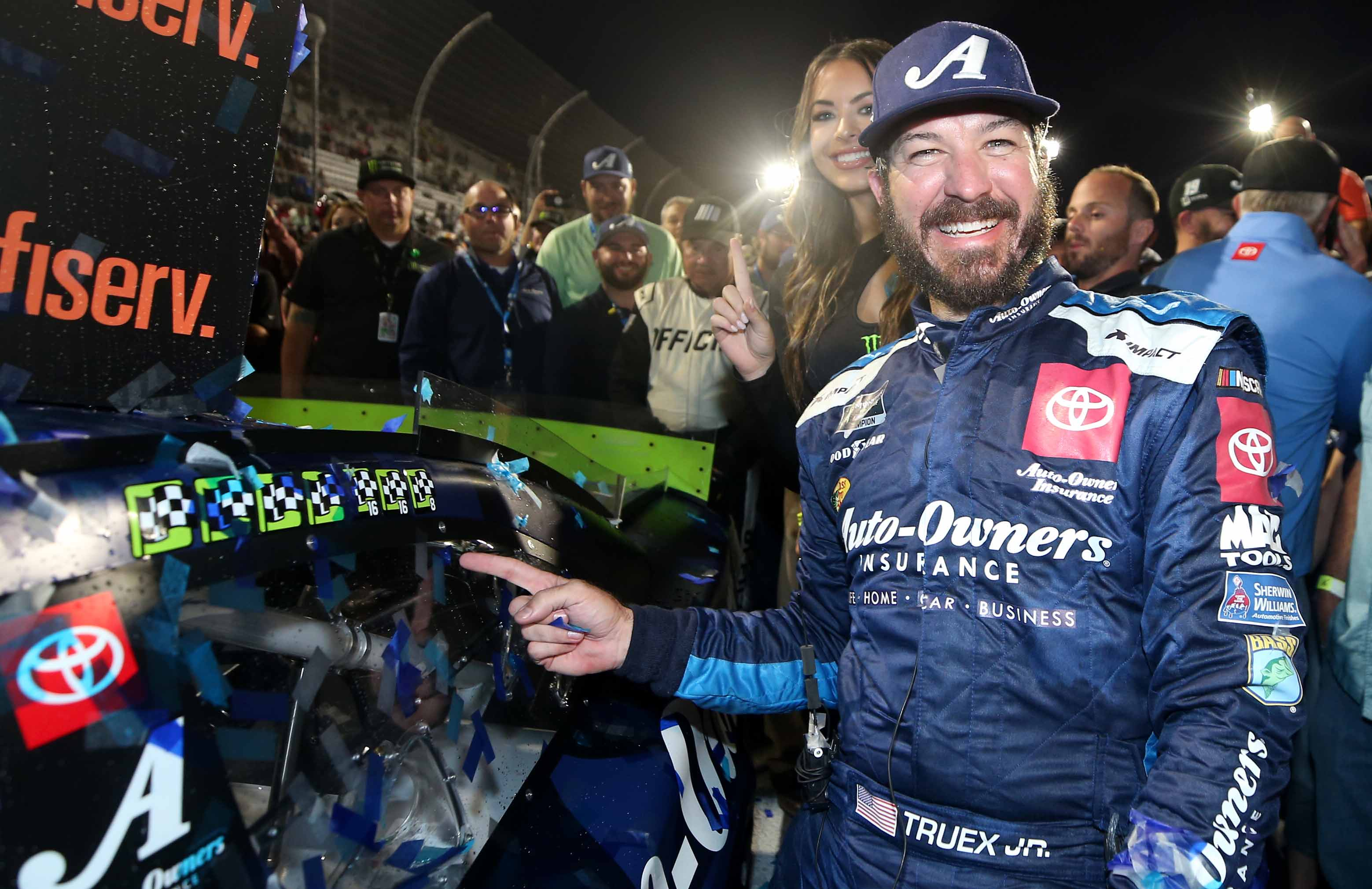 Martin Truex Jr and the Monster Energy Girl in victory lane at Martinsville Speedway