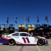 Denny Hamlin rolls in the NASCAR garage area at Texas Motor Speedway
