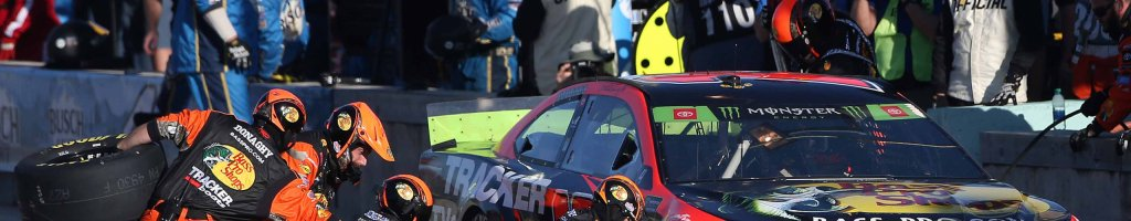 Martin Truex Jr talks the tire swap during pit stop at Homestead-Miami Speedway