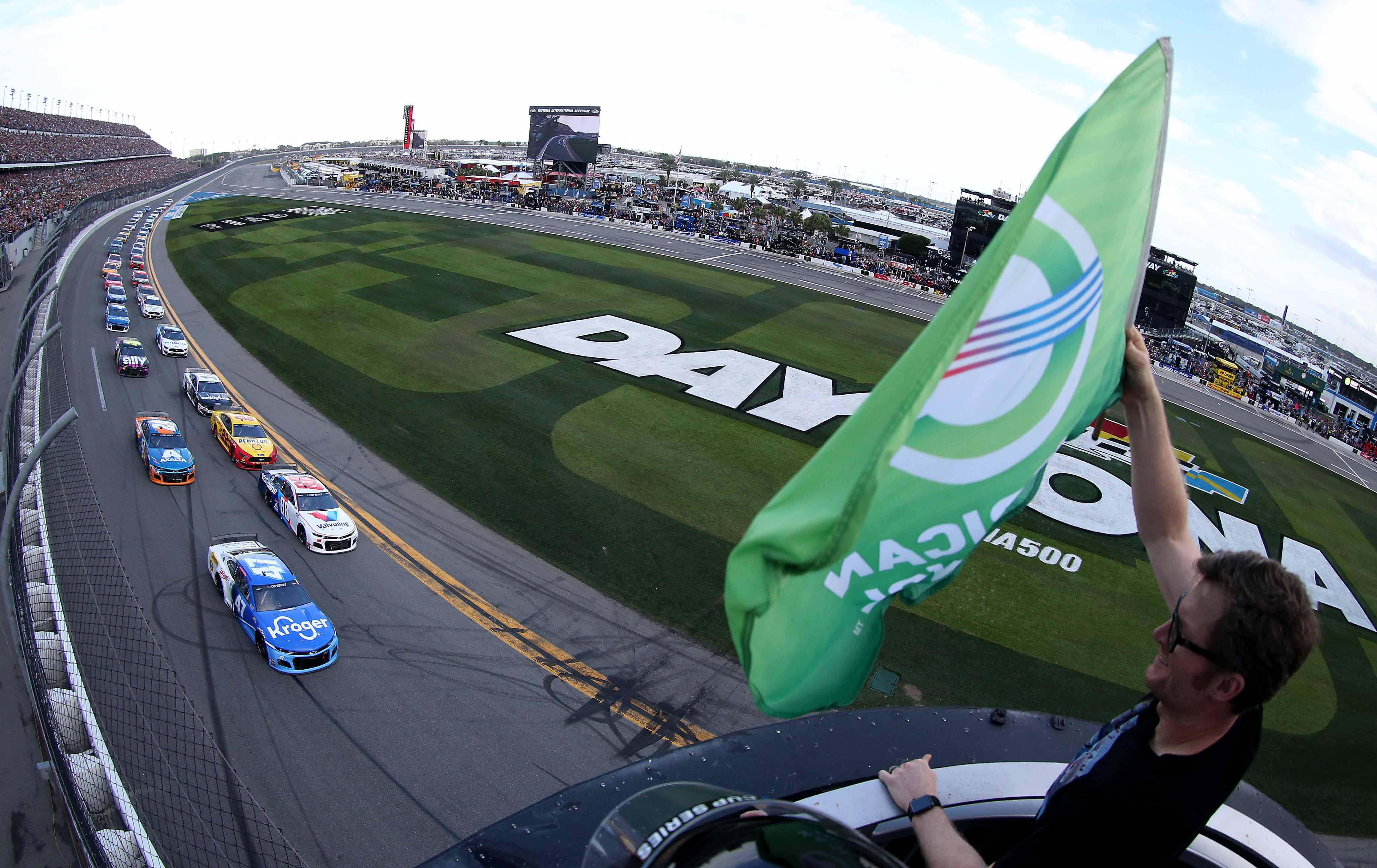 Dale Earnhardt Jr waves the green flag for the Daytona 500 - NASCAR Cup Series