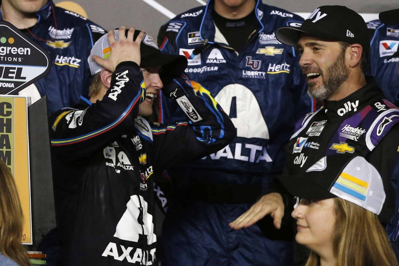 William Byron and Jimmie Johnson in victory lane