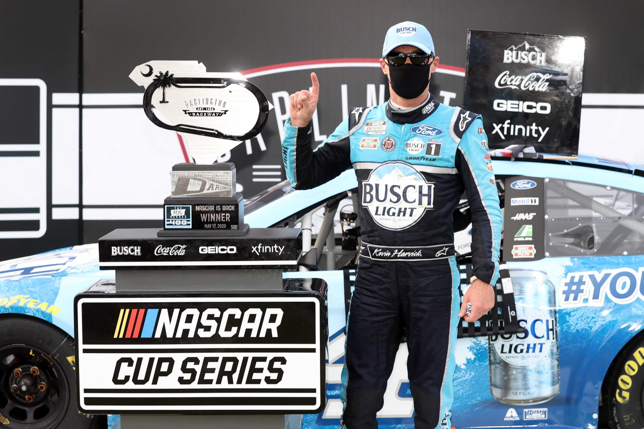 Kevin Harvick in victory lane with a mask - Darlington Raceway