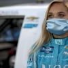 Natalie Decker in a mask - NASCAR Truck Series