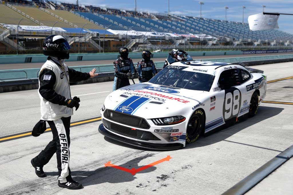 Chase Briscoe held by NASCAR officials