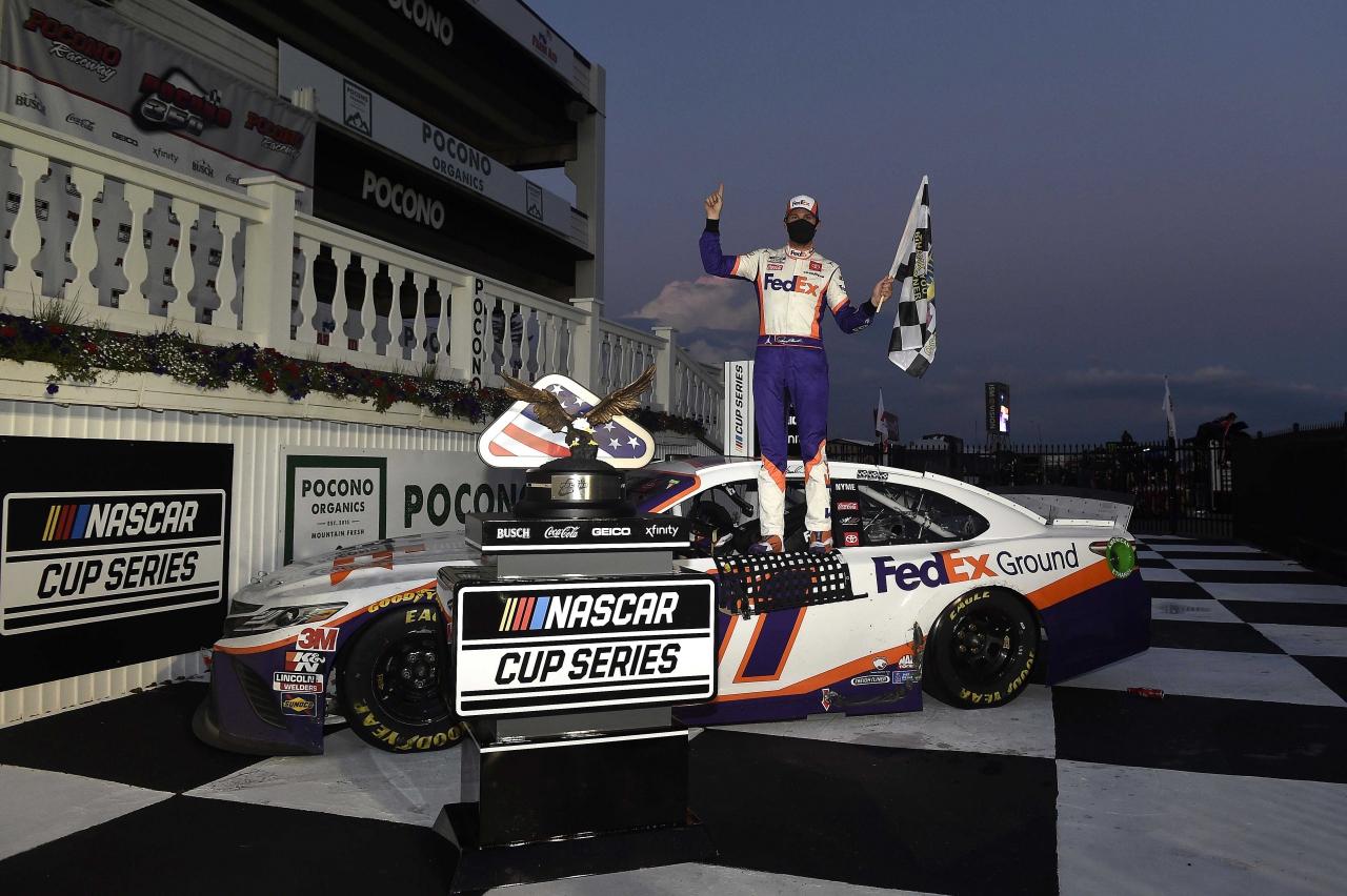 Denny Hamlin in victory lane at Pocono Raceway - NASCAR Cup Series