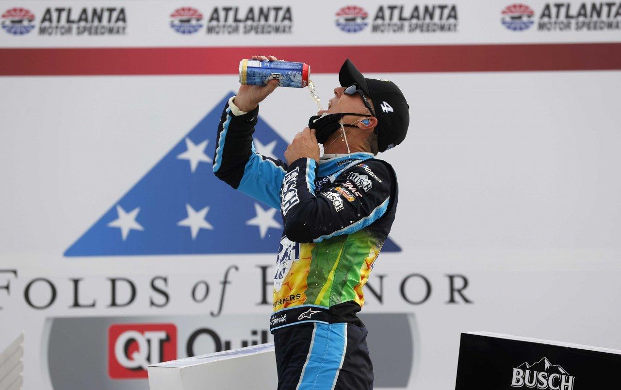 Kevin Harvick drinks Busch beer in victory lane at Atlanta Motor Speedway