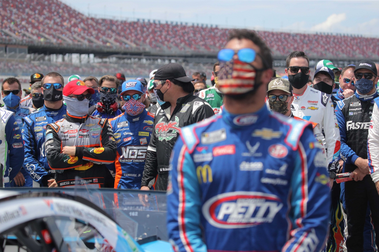 NASCAR drivers stand with Bubba Wallace
