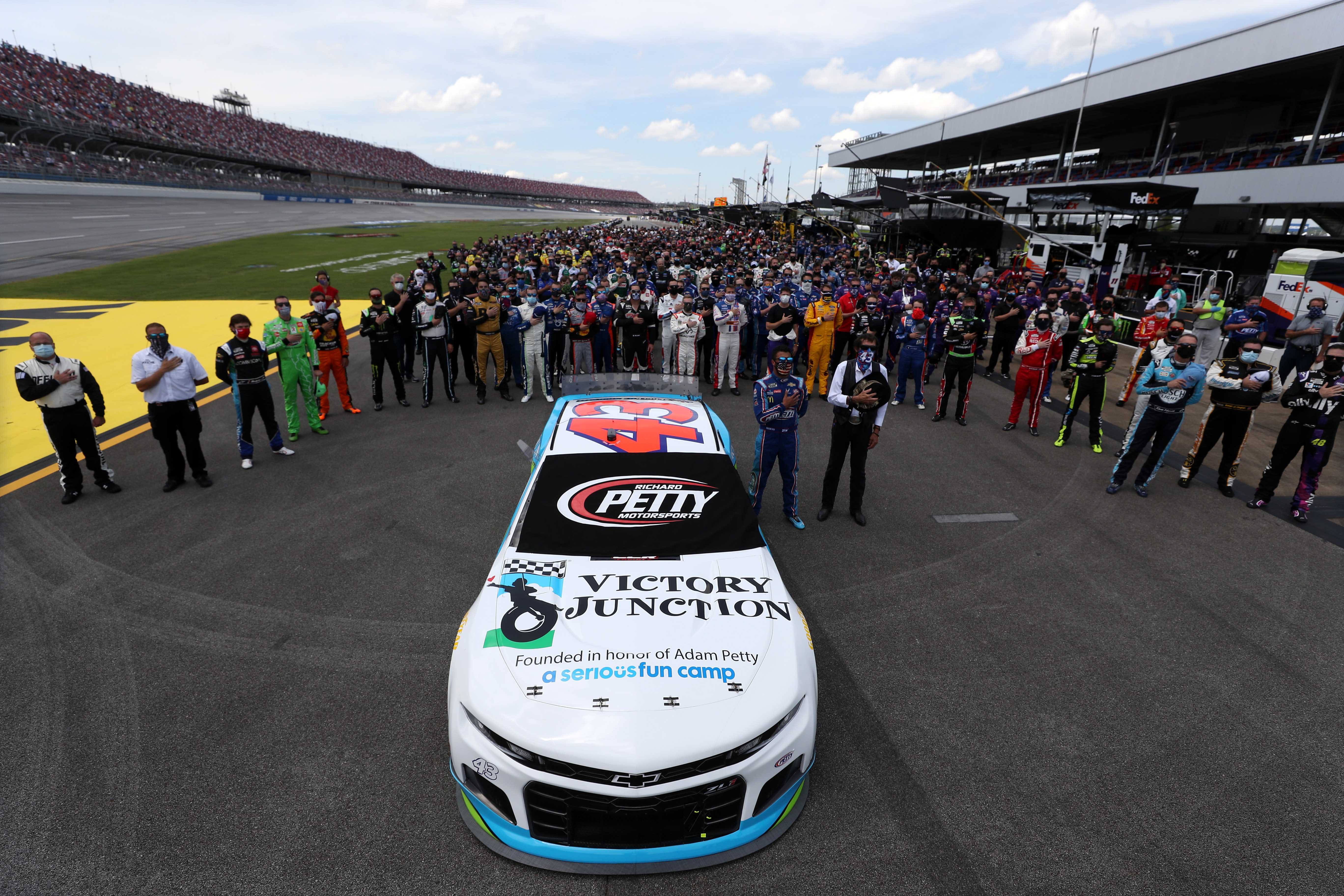 NASCAR stands with Bubba Wallace at Talladega Superspeedway