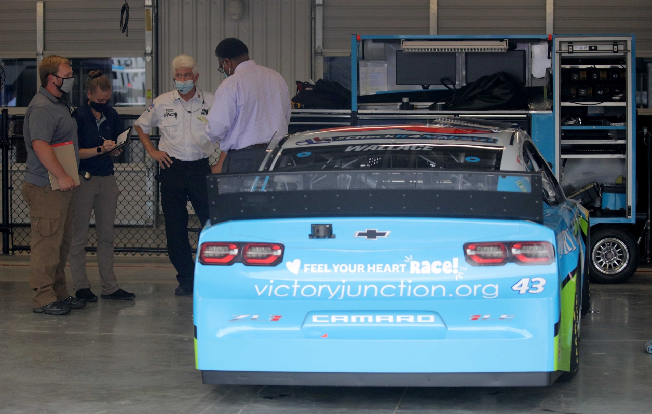 Police and FBI in the NASCAR garage stall of Bubba Wallace - NASCAR Cup Series at Talladega Superspeedway