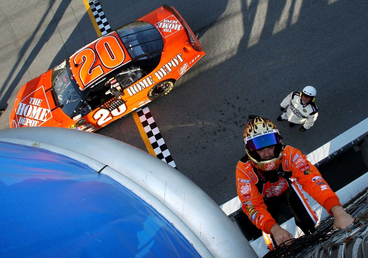 Tony Stewart climbs the fence in 2007 at Chicagoland Speedway - NASCAR Cup Series