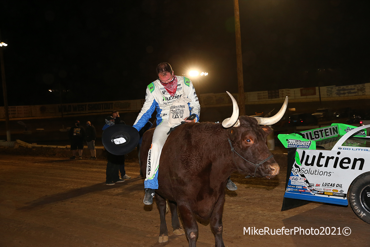 Jonathan Davenport rides a bull in victory lane at Wild West Shootout