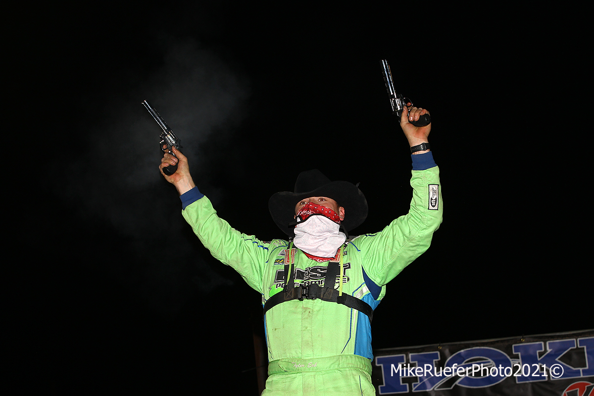 Tyler Erb shoots guns in victory lane