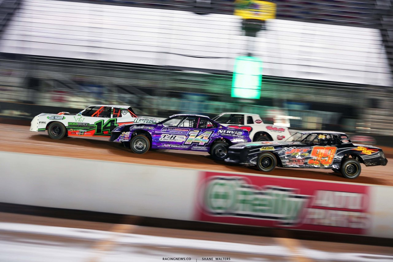 Four wide stock car racing on the Bristol Motor Speedway dirt track 0636