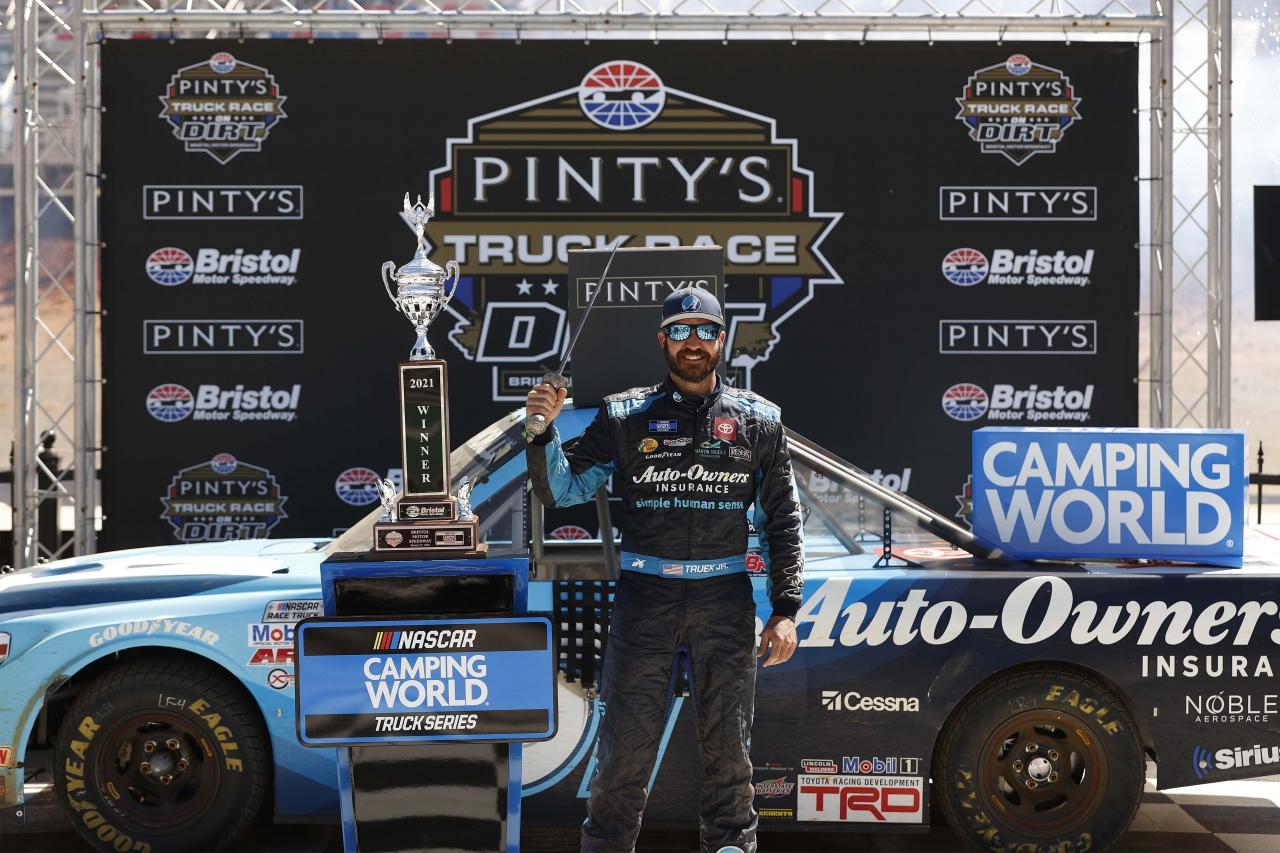 Martin Truex Jr stands in victory lane - Bristol Motor Speedway dirt track - NASCAR Truck Series