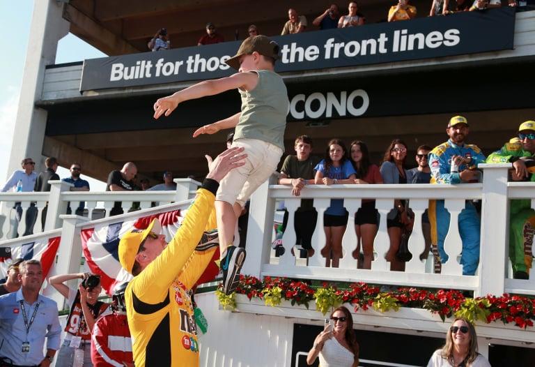 Kyle Busch, Brexton Busch and Samantha Busch in victory lane - Pocono Raceway - NASCAR Cup Series