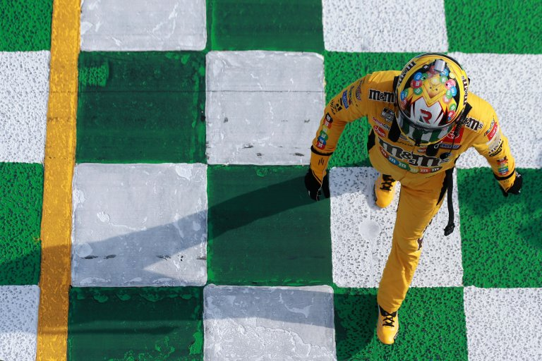 Kyle Busch collects the flag - Atlanta Motor Speedway - NASCAR Xfinity Series