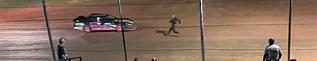 Racing driver kicks moving race car in rage, breaks leg (Video)