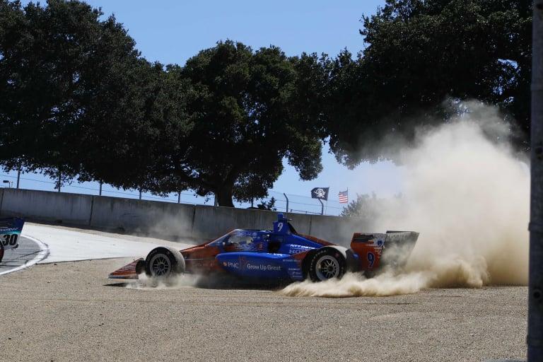 Scott Dixon in dirt at Laguna Seca - Indycar Series