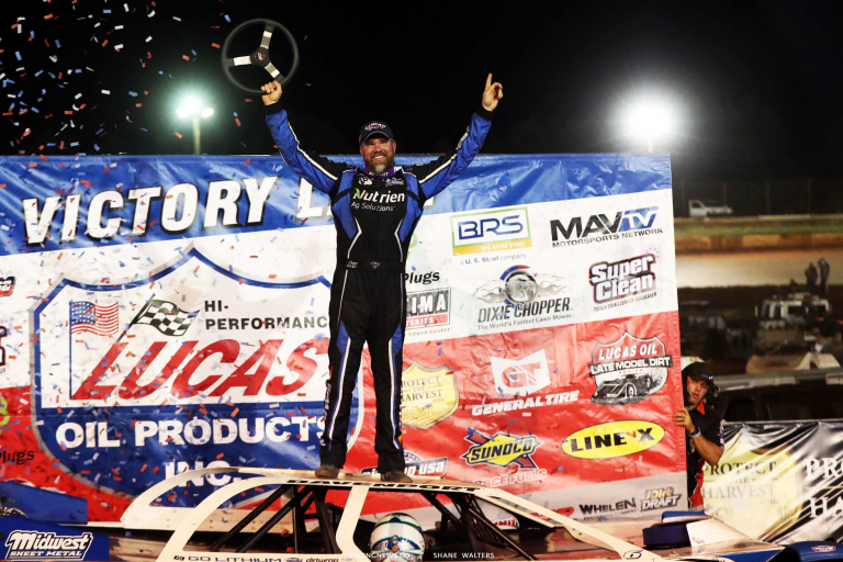 Jonathan Davenport stands in victory lane at Rome Speedway - Lucas Oil Late Model Dirt Series A35I0672